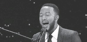 ?? WILLY SANJUAN/ INVISION/ AP ?? John Legend, performing at the Alliance for Children's Rights' dinner in Beverly Hills, Calif in March 2020, is returning to the road in 2021.