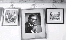 ?? Ben Curtis Associated Press ?? A PHOTO of Barack Obama Sr. hangs in the home of Sarah Obama, the president's stepgrandmother. Villagers in Kogelo have a deep reverence for ancestors.