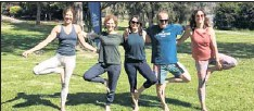 ??  ?? MORNING WORKOUT: Last Thursday (from left) Shelley Herman, Maureen Ryland, Amber Knight, Mario Mariethoz and Marta Keenan participated in a free yoga session at Mt Beauty as part of Active April.
