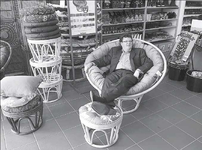 """?? PHOTOS: GRAHAM HUGHES THE GAZETTE ?? Martin Bureau in a papasan chair in the Westmount Pier 1 Imports: """"Rattan is more sturdy than you think. In Indonesia, when they build a skyscraper, they use scaffolding made from rattan. I can't think of a more ringing endorsement for sturdiness."""""""