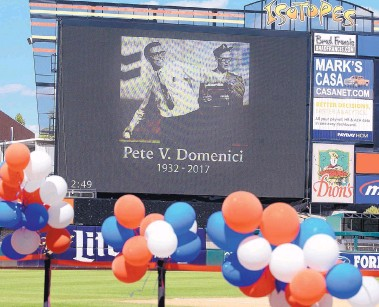 ?? JIM THOMPSON/JOURNAL ?? A picture of Sen. Pete Domenici throwing out the first pitch at a baseball game was on the big screen at Isotopes Park during a memorial service for Domenici at the ballpark Saturday.