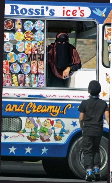 ??  ?? A woman in a full face veil runs the ice cream van in the Savile Town area