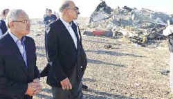 ??  ?? Tourism minister Hisham Zaazou (left) and Ismail look at the remains of the Russian airliner in central Sinai near El Arish city on Saturday.