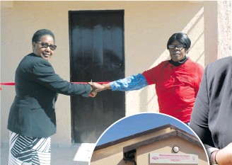 ??  ?? Melita Mampane (PCS, CEO) and Modipadi Rehab Dimo (Mahlahlalane Drop-in Centre, Manager) cut the ribbon. Insert: New building donated to Mahlahlalane Drop-in Centre by PCS on Friday. Right: Maggie Mampane (PCS, Marketing Manager) speaks about the purpose of the event.