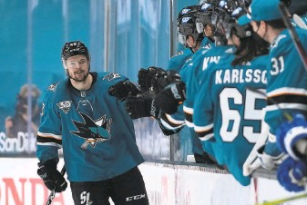 ?? Tony Avelar / Associated Press ?? Teammates congratulate Sharks center Tomas Hertl after his secondperiod goal in a 32 win over Colorado at SAP Center. It marked Hertl's 500th career game.