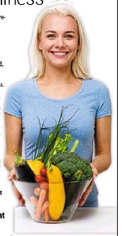 ??  ?? Healthy eating, vegetarian food, dieting and people concept smiling young woman with bowl of vegetables at home.