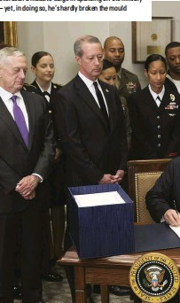 ??  ?? The pen and the sword Trump signs the National Defense Authorization Act for 2018 in the White House. The 45th president has overseen a massive surge in spending on the military — yet, in doing so, he's hardly broken the mould