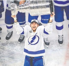 ?? Pery Nelson / USA TODAY Sports ?? Tampa Bay Lightning centre Anthony Cirelli hoists the Stanley Cup on Monday in Edmonton. He could well see an offer sheet coming to him.