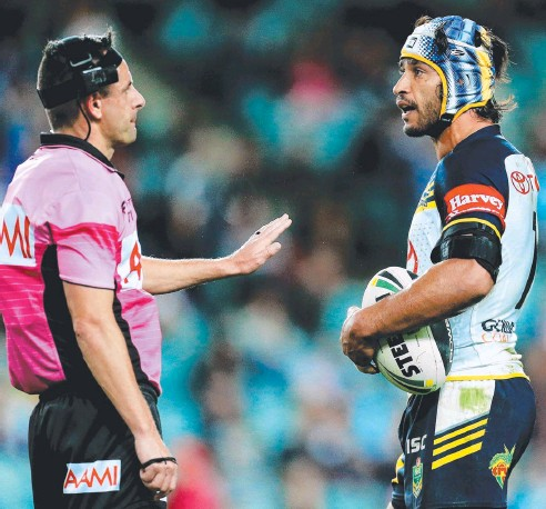 ??  ?? ALL STICK AND NO RHYTHM: Cowboys captain Johnathan Thurston argues with referee Gavin Badger during last season's semi-final against the Roosters at Allianz Stadium. Picture: Mark Evans