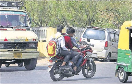 ?? HT ARCHIVES ?? ■ The new set of rules make it mandatory for children above the age of 4 years to wear helmets while riding two-wheelers and for children above the age group of 14 years to wear seat belts.