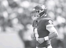 ?? JONATHAN NEWTON/THE WASHINGTON POST ?? Washington quarterback Taylor Heinicke completed 11 of 15 passes for 122 yards and a touchdown after replacing Ryan Fitzpatrick.