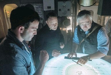 ??  ?? Naval consultant Gordon Laco, right, works with Stephen Graham, centre, on the set of Greyhound.