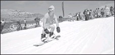 ?? By Nathan Bilow, AP ?? Spring surge: Late-season snow had people hitting the slopes, including this snowboarder dressed for warm weather at Crested Butte Mountain Resort.