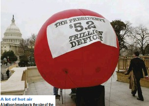 ??  ?? A lot of hot air A balloon broadcasts the size of the deficit under President George W Bush, Washington DC, 2004. Trump, too, has faced criticism for presiding over a huge hike in the national debt