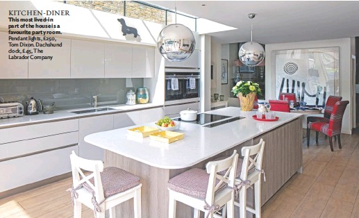??  ?? KITCHEN-DINER This most lived-in part of the house is a favourite party room. Pendant lights, £250, Tom Dixon. Dachshund clock, £45, The Labrador Company