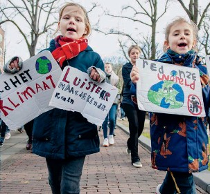 ??  ?? Opposite page: a protest in Groningen, the Netherlands, against the fossil fuel industry, 28 August 2018 This page: in The Hague, children take part in an event to demand greater political awareness of climate issues, 7 February 2019, inspired by similar protests by students in Belgium recently