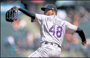 ?? PHOTOS BY DANIEL SHIREY / Getty Images ?? Rockies pitcher German Marquez throws a pitch in Sunday's game against the Giants at Oracle Park in San Francisco.