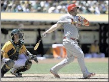 ?? BEN MARGOT/ASSOCIATED PRESS ?? St. Louis rookie Matt Adams hits a three-run home run off A's reliever Jerry Blevins in the sixth inning Saturday in Oakland, Calif.