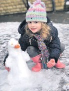 ??  ?? • Rose Tudor, aged 5, with her snow penguin