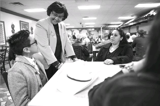 ?? Photos by Ashley Landis/Staff Photographer ?? Lupe Valdez, former sheriff of Dallas County, visited recently with 10-year-old Christian Villarreal and his mothers, Lisa Villarreal and Adriana Villarreal, during a campaign stop at Martinez Bakery in Midland. Valdez has worked as a corrections...