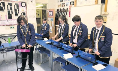 ??  ?? On the beat Senior pupils drum up some interest in the steel band