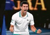 ?? Andy Brownbill / Associated Press ?? Novak Djokovic rejoices after beating Daniil Medvedev for a third straight Australian Open title.