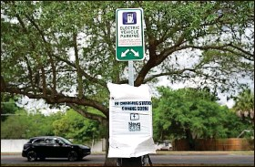 ?? JOHN RAOUX   Associated Press ?? A parking area with charging stations for electric vehicles is seen in Orlando. The Biden administration seeks $174 billion to build 500,000 charging stations in the U.S.