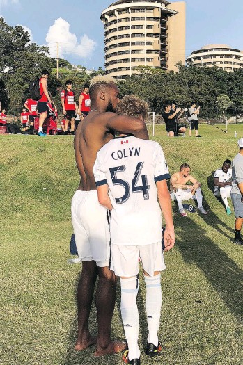 ?? WHITECAPS/INSTAGRAM ?? Kendall Waston gives 15-year-old Whitecaps residency player Simon Colyn a hug after he made his first-team debut in Hawaii in a friendly against the Hokkaido Consadole Sapporo squad.