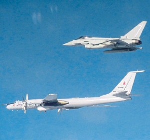 ??  ?? A Typhoon intercepts a Russian Tupolev Tu-142 as it approaches UK airspace