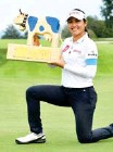 ?? Bangkok Post Photo: ?? Atthaya Thitikul poses with the trophy after winning the Swiss Ladies Open.