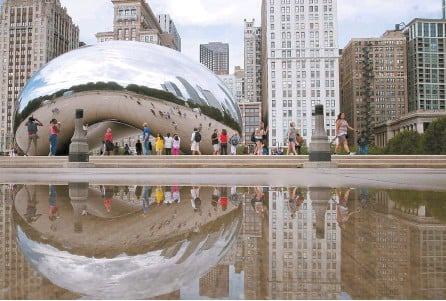 ?? Chicago Tribune-Tribune News ?? The Cloud Gate sculpture is reflected in a puddle in a puddle at Millennium Park on South Michigan Avenue in Chicago, Ill. in this Aug. 26, 2016, file photo.