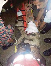 ??  ?? The injured victim being strapped onto a stretcher.