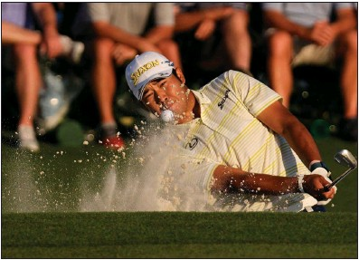 ??  ?? ABOVE Hideki Matsuyama hits out of a bunker to the 18th green during the final round of The Masters on Sunday in Augusta, Ga. Matsuyama closed with a 1-over 73 for a one-shot victory over Will Zalatoris to become the first Japanese winner of the event.
