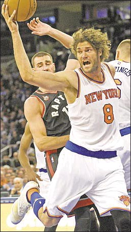 ?? PHOTO BY AP ?? Knicks center Robin Lopez, much like his teammates, has nowhere to go in blowout loss to the Raptors in the Garden.