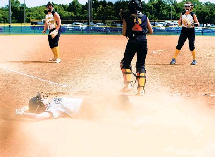 ?? PAUL W. GILLESPIE/CAPITAL GAZETTE PHOTOS ?? North County's Becca Gottleib takes a moment to get up after being tagged out at home trying to score what would have been the tying run by Catonsville catcher Devyn Tracy in the seventh inning of Friday's Class 4A state softball championship game.