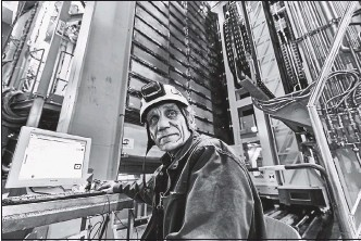 ?? 2018, CERN VIA THE ASSOCIATED PRESS ?? Nikolai Bondar works on the LHCb Muon system at CERN's Large Hadron Collider facility outside Geneva. Experimental results from here and the U.S. Fermilab challenge the way physicists think the universe works.