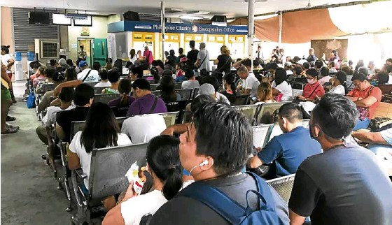??  ?? LONG WAIT (Above) Patients wait to be called at the Philippine Charity Sweepstakes Office (PCSO). (Left) At P84,000 for two vials, Herceptin users run to the PCSO for help.