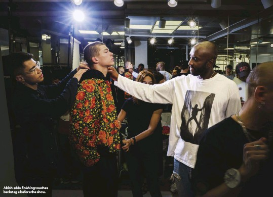 ??  ?? Abloh adds finishing touches backstage before the show.