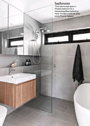 ??  ?? bathroom There was enough space in Phoebe's bathroom for a freestanding Ellisse bathtub by Parisi. The taps in both wet areas are by Phoenix Tapware.