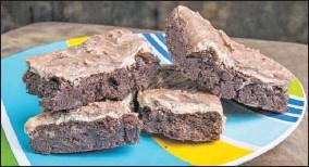 ?? DREAMSTIME ?? Gooey, chocolate-y fudge brownies.