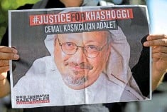 ?? — AFP photo ?? File photo shows friends of murdered Khashoggi holding posters bearing his picture as they attend an event marking the second-year anniversary of his assassination in front of Saudi Arabia Istanbul Consulate.