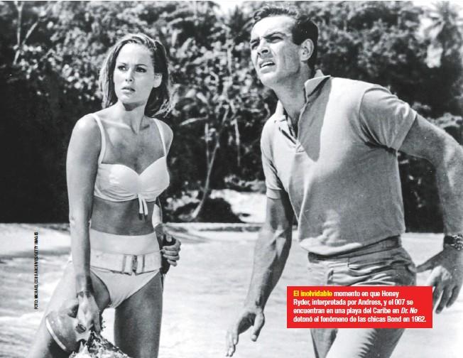 ??  ?? El inolvidable momento en que Honey Ryder, interpretada por Andress, y el 007 se encuentran en una playa del Caribe en Dr. No detonó el fenómeno de las chicas Bond en 1962.