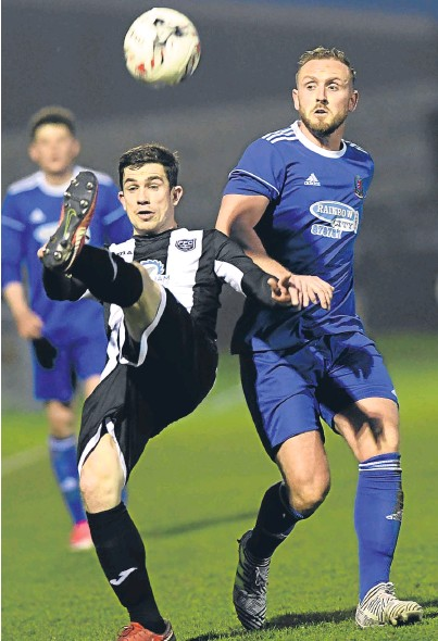 ??  ?? EYE ON THE BALL: Jonny Smith, right, reck­ons Cove Rangers are pre­pared for league foot­ball