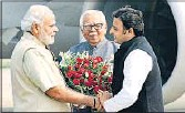 ??  ?? Governor Ram Naik and chief minister Akhilesh Yadav welcoming PM Narendra Modi in Varanasi on Friday.
