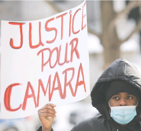 ?? GRAHAM HUGHES / THE CANADIAN PRESS ?? People attend a We Are All Camara protest in Montreal on Saturday, calling for justice for Mamadi III Fara Camara,