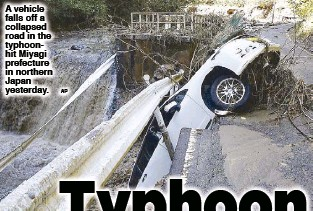 ?? AP ?? A ve­hi­cle falls off a col­lapsed road in the ty­phoonhit Miyagi pre­fec­ture in north­ern Ja­pan yes­ter­day.