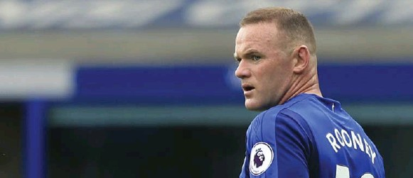 ?? LINDSEY PARNABY/AFP/GETTY IMAGES ?? Wayne Rooney spent 13 years with Manchester United, was the team's most recent captain and set the club's all-time scoring record with 253 goals.