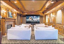 ??  ?? A HOME THEATER is among the amenities.