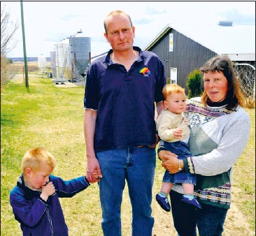 ?? Walter Tychnowicz, Edmonton Journal ?? Alberta hog farmer Arnold Van Ginkel, with wife Alida and sons Paul, 5, and Daniel, 11 months, says because of swine flu he can neither sell his animals nor continue to house them, as they reproduce at a rate of about 100 a week.