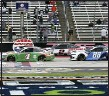 ?? RICHARD W. RODRIGUEZ — THE ASSOCIATED PRESS ?? Kevin Harvick (4), Brad Keselowski (2) and Alex Bowman (88) cross the starting line to begin a NASCAR Cup Series auto race at Texas Motor Speedway in Fort Worth, Texas, Oct. 25.